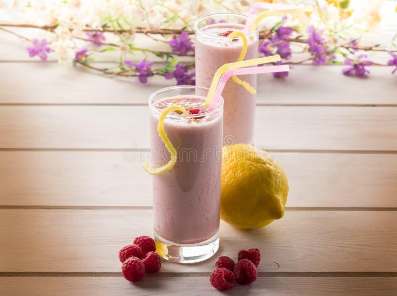 Raspberry milkshake on glass royalty free stock images