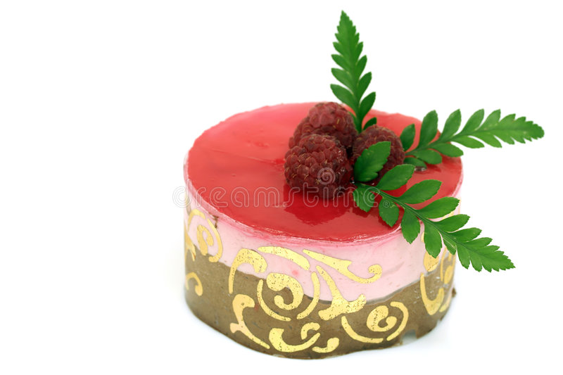 Raspberry mousse cake. Individual raspberry mousse cake with fruits and chocolate royalty free stock photo
