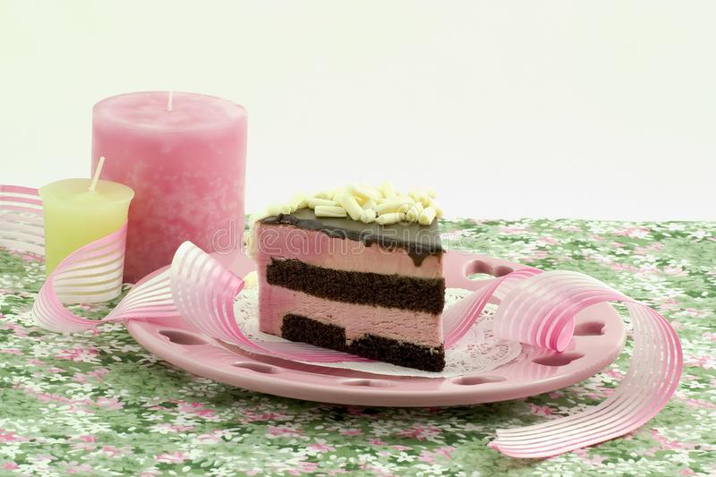Raspberry mousse with candles stock images