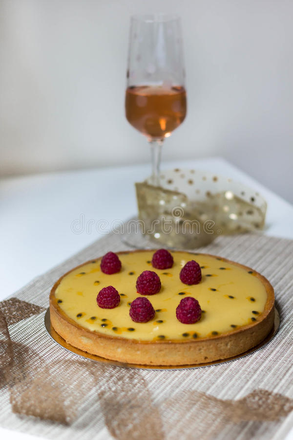 Raspberry and passion fruit tart stock photography