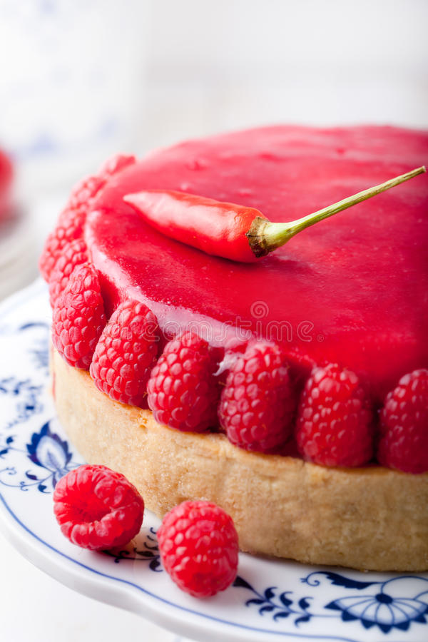 Raspberry and roast bell pepper mousse cake, cheesecake chili stock photo
