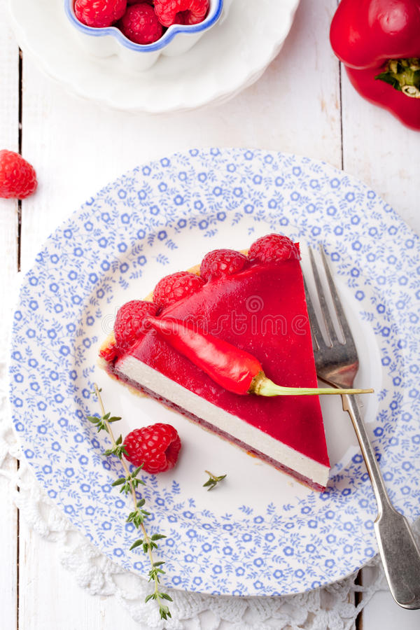 Raspberry and roast bell pepper mousse cake, cheesecake chili stock photos