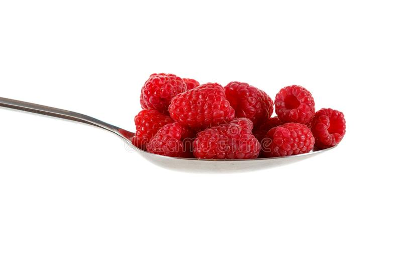 Raspberry in stainless steel spoon isolated against white. Background stock image