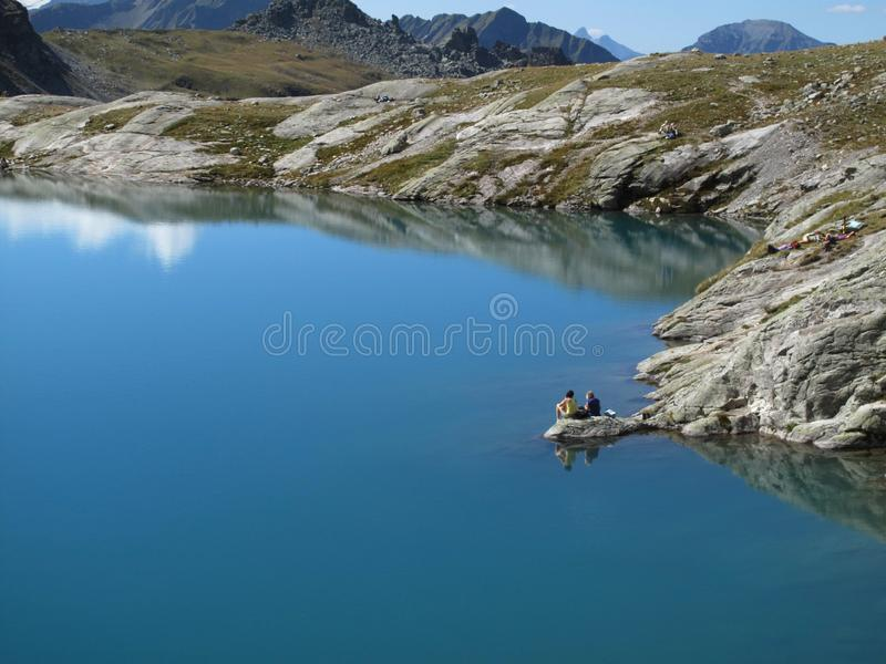 Rest on the Schottensee, 5-lake hike, CHRest on the Schottensee, 5-lake hike, CH royalty free stock image