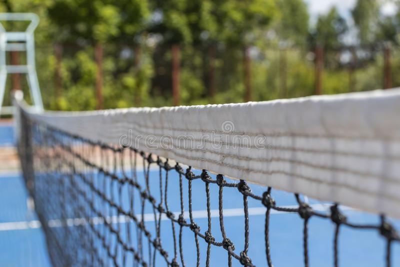 Raster p? tennisbanan som en bakgrund arkivbild