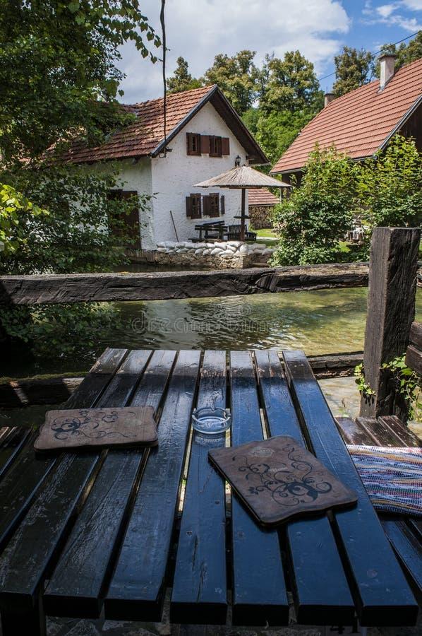 Rastoke, Plitvice湖区域,克罗地亚,欧洲,水车,河,木房子,风景,地平线 免版税图库摄影