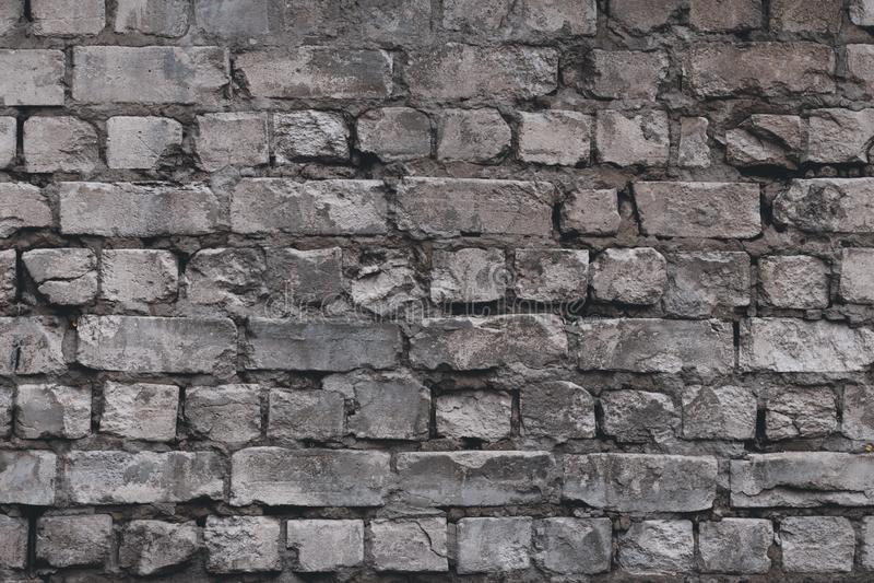 Παλαιό υπόβαθρο τοίχων πετρών Υπόβαθρο τουβλότοιχος Γκρίζος κατασκευασμένος συμπαγής τοίχος Τραχύς βράχος σύστασης Συγκεκριμένο υ στοκ φωτογραφία με δικαίωμα ελεύθερης χρήσης