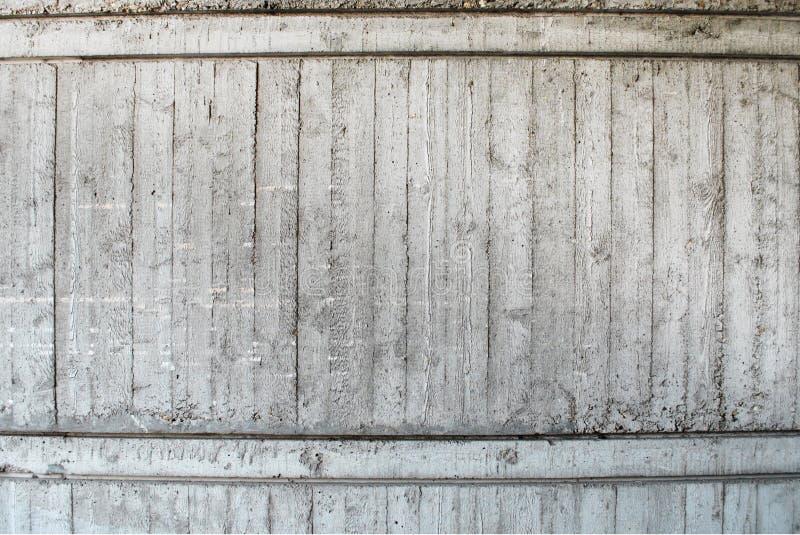 Rastros concretos de tableros de la bufanda en la pared foto de archivo libre de regalías