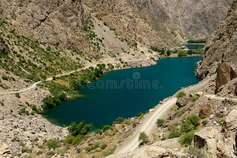 Rastros de los lagos en las montañas de la fan, Tayikistán mango-Kul siete fotos de archivo libres de regalías