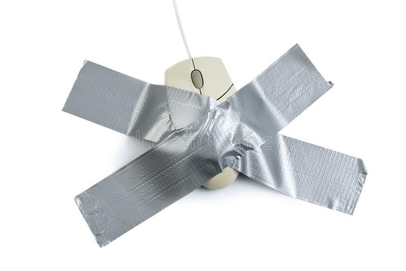 Ratón del ordenador con la cinta fotografía de archivo libre de regalías