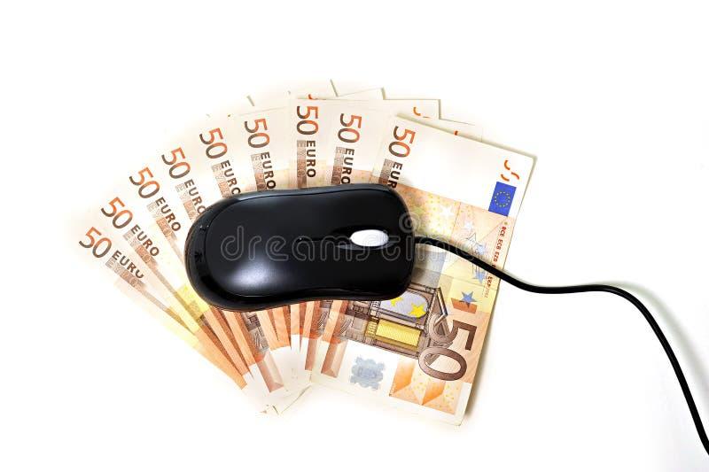 Ratón del ordenador en billetes de banco fotos de archivo libres de regalías