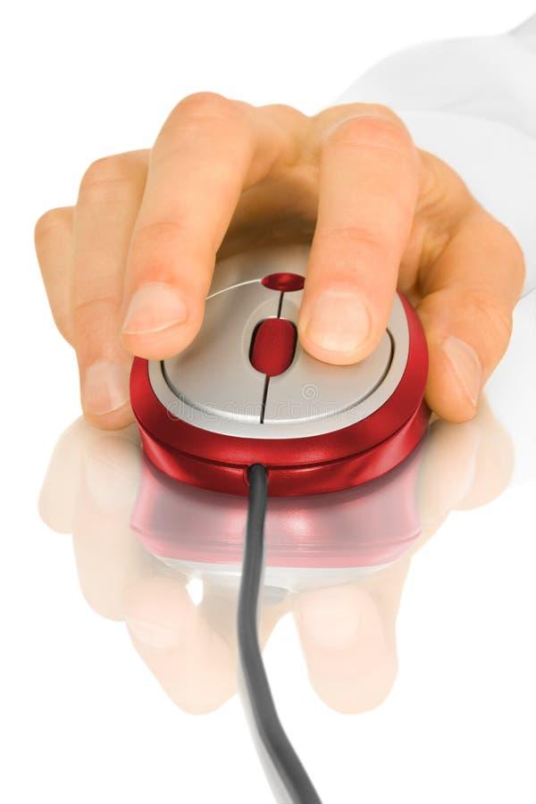 Ratón y mano del ordenador imagen de archivo