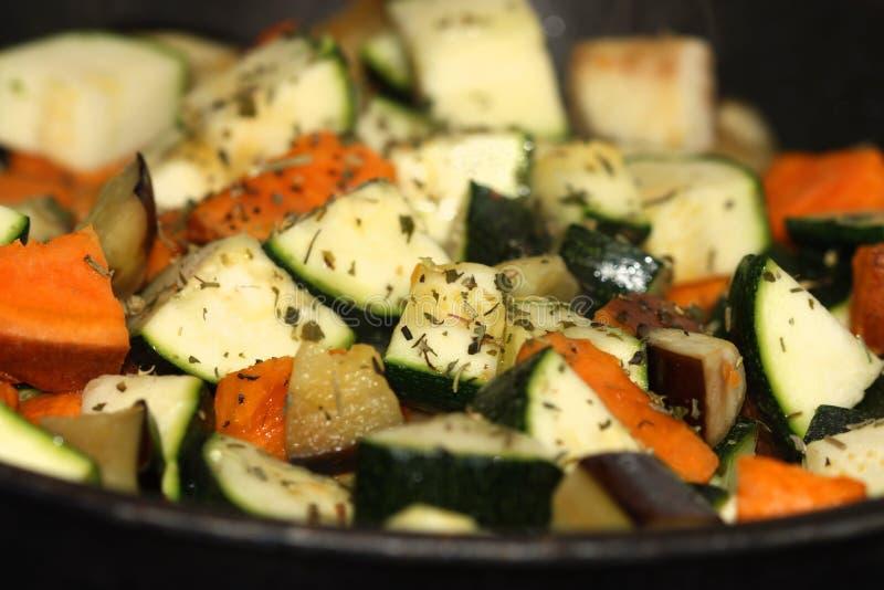 Ratatouille. Preparing ratatouille in pan with sweet potato, aubergine and zucchini squash. Shallow depth of field royalty free stock photo