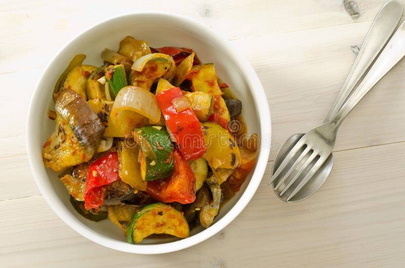 Ratatouille. Roasted ratatouille vegetables in a white bowl royalty free stock photography