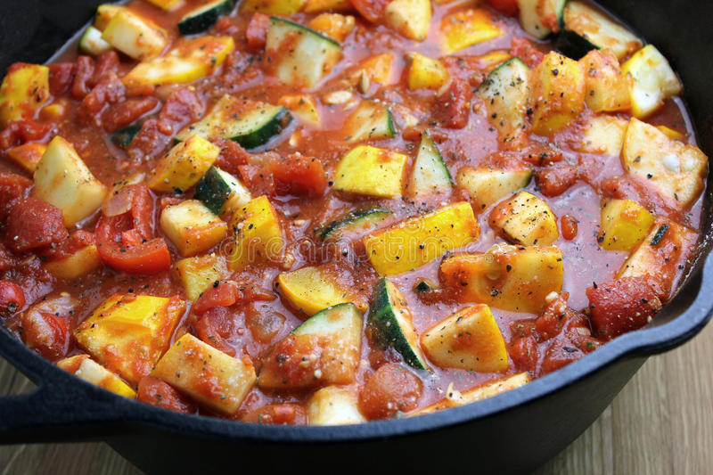 Ratatouille. A cast iron pot of freshly made ratatouille with vegetables from the garden stock photography