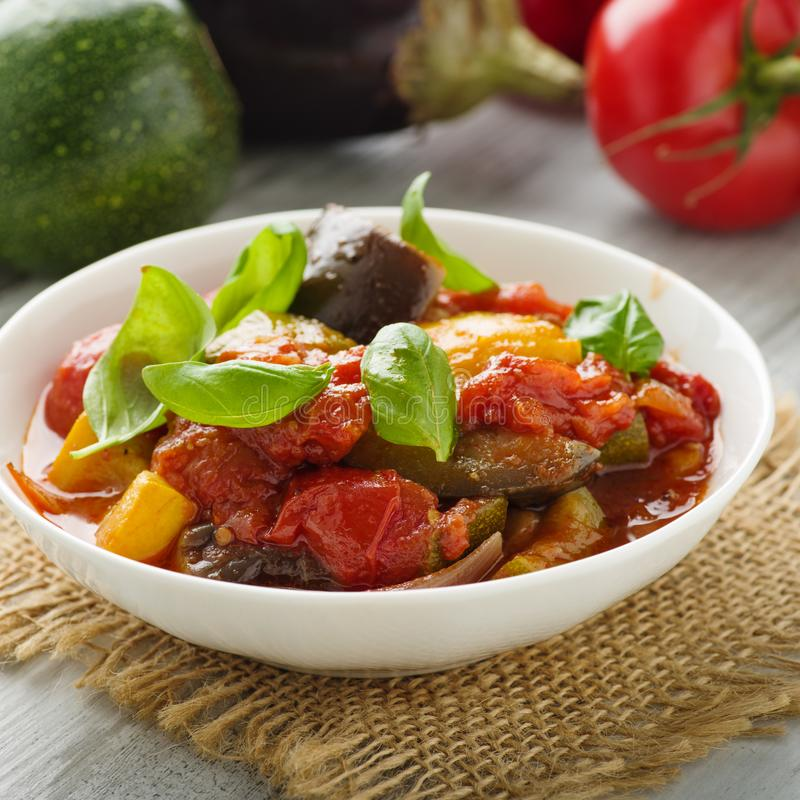 Ratatouille. French vegetable stew with tomotoes, aubergines, courgettes and peppers royalty free stock photography