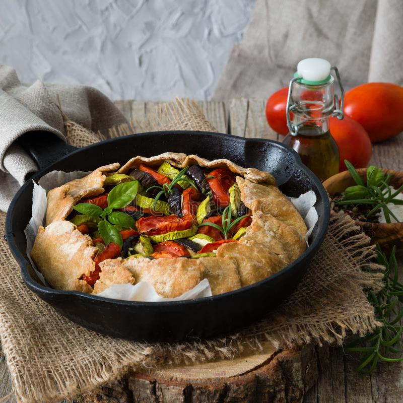 Ratatouille galette pie on rustic background. Copy space stock images
