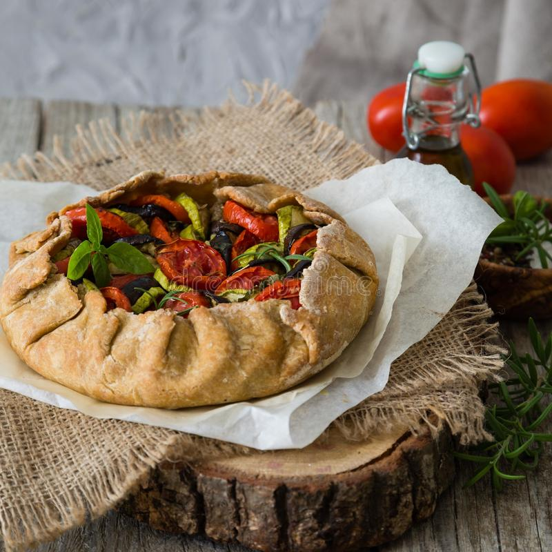 Ratatouille galette pie on rustic background. Copy space stock image