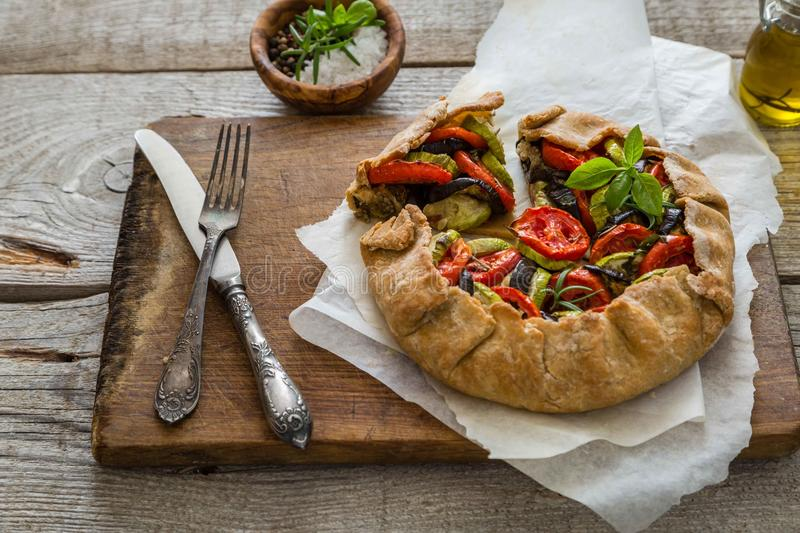 Ratatouille galette pie on rustic background. Copy space royalty free stock images
