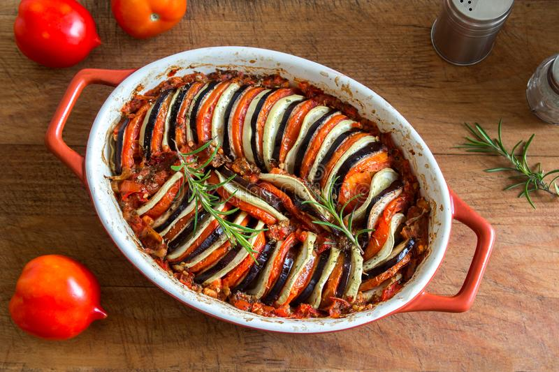 Ratatouille. Traditional French Provencal vegetable dish cooked in oven. Diet vegetarian vegan food -  casserole stock images