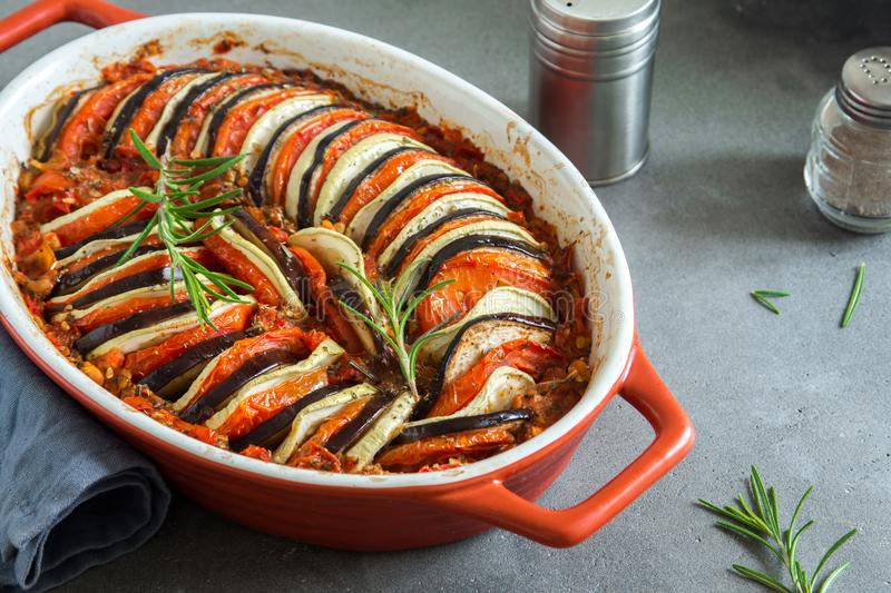 Ratatouille. Traditional French Provencal vegetable dish cooked in oven. Diet vegetarian vegan food -  casserole stock photos