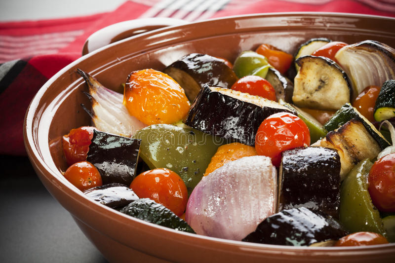 Ratatouille Roasted Mediterranean Vegetables. An earthenware dish filled with oven baked Medieterranean vegeatbles, or ratatouille stock images