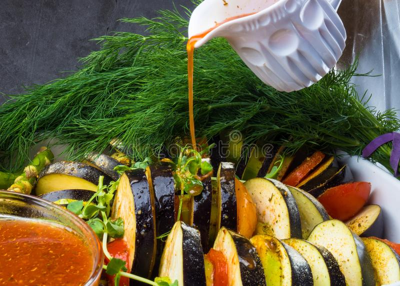 Ratatouille - traditional French Provencal vegetable dish cooked in oven pouring with tomato, olive oil sauce. Health food, vegan royalty free stock photo