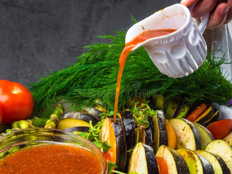 Ratatouille - traditional French Provencal vegetable dish cooked in oven pouring with tomato, olive oil sauce. Health food, vegan stock photos