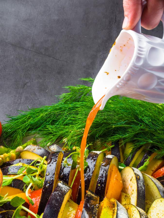 Ratatouille - traditional French Provencal vegetable dish cooked in oven pouring with tomato, olive oil sauce. Health food, vegan stock image