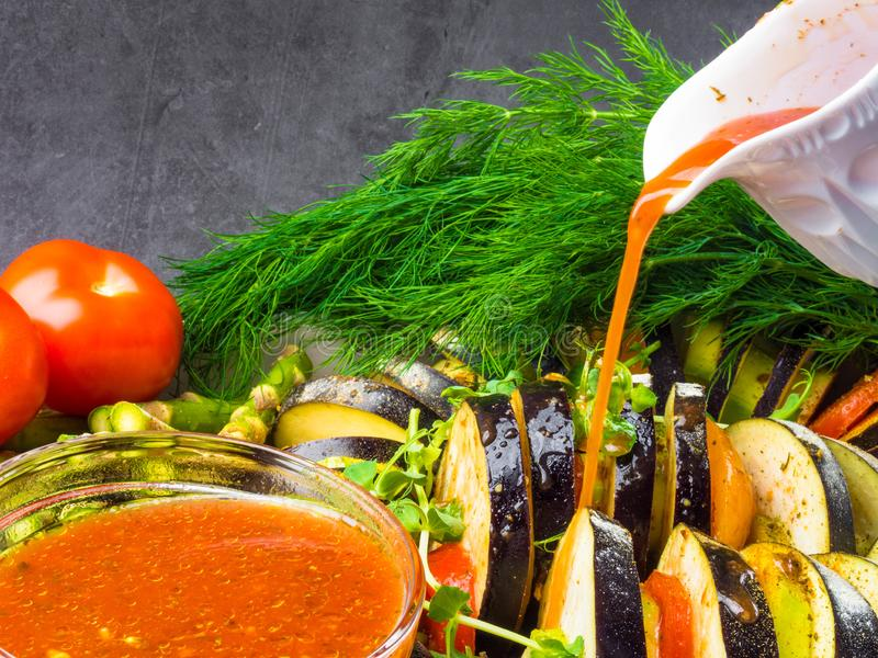 Ratatouille - traditional French Provencal vegetable dish cooked in oven pouring with tomato, olive oil sauce. Health food, vegan royalty free stock image