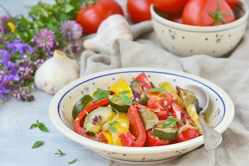 Ratatouille. The ratatouille, traditional French vegetable stew in a ceramic dish. rustic style stock images