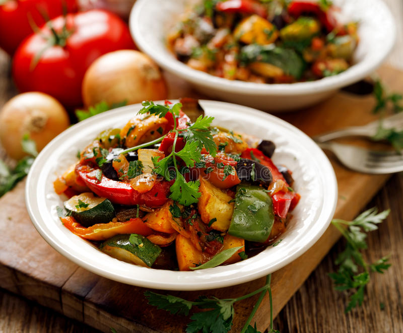Ratatouille, Vegetable stew made of zucchini, eggplants, peppers, onions, garlic and tomatoes with aromatic herbs. Ratatouille, Vegetarian stew made of zucchini stock photo