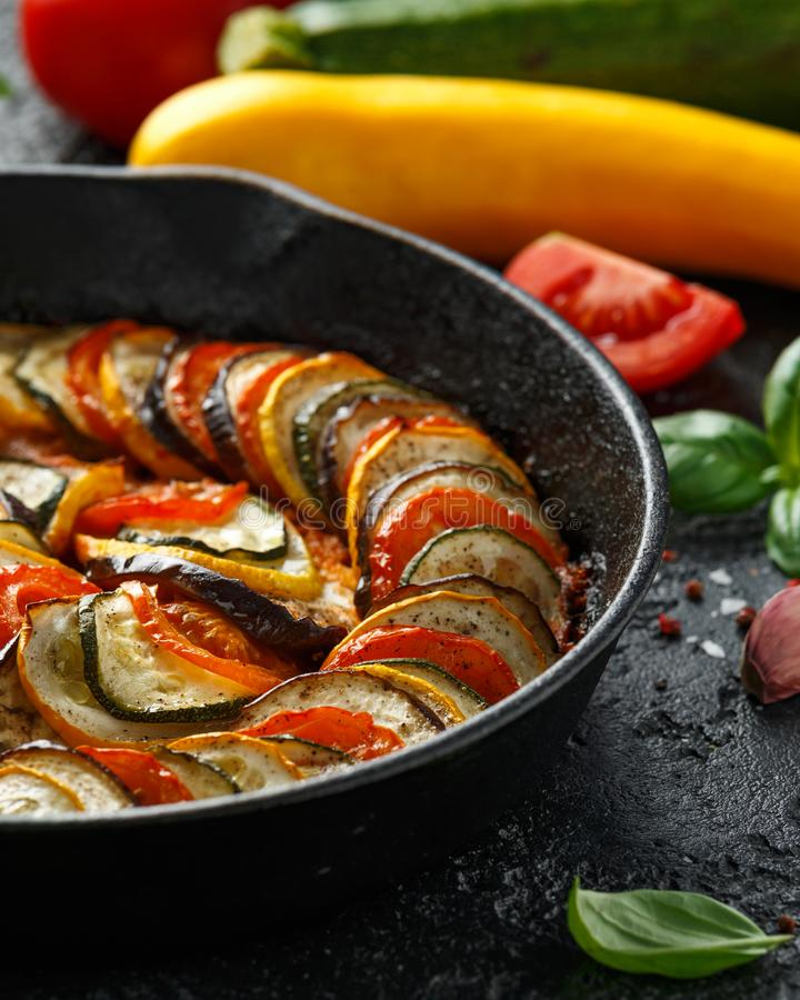Ratatouille Vegetable Stew with zucchini, eggplants, tomatoes, garlic, onion and basil. on cast iron pan. Traditional French food.  stock image