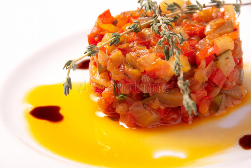 Ratatouille vegetables. On the white plate stock images