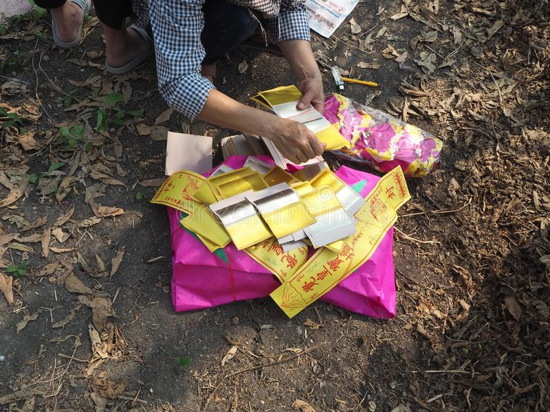Ratchaburi , Thailand - April 05,2018 : Chinese gold joss paper are also burned in Asian funeral use for burning to ancestor in th royalty free stock photo