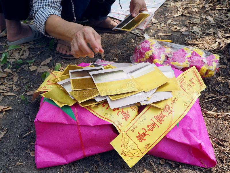 Ratchaburi , Thailand - April 05,2018 : Detail of Chinese gold joss paper are also burned in Asian funeral use for burning to ance royalty free stock photos
