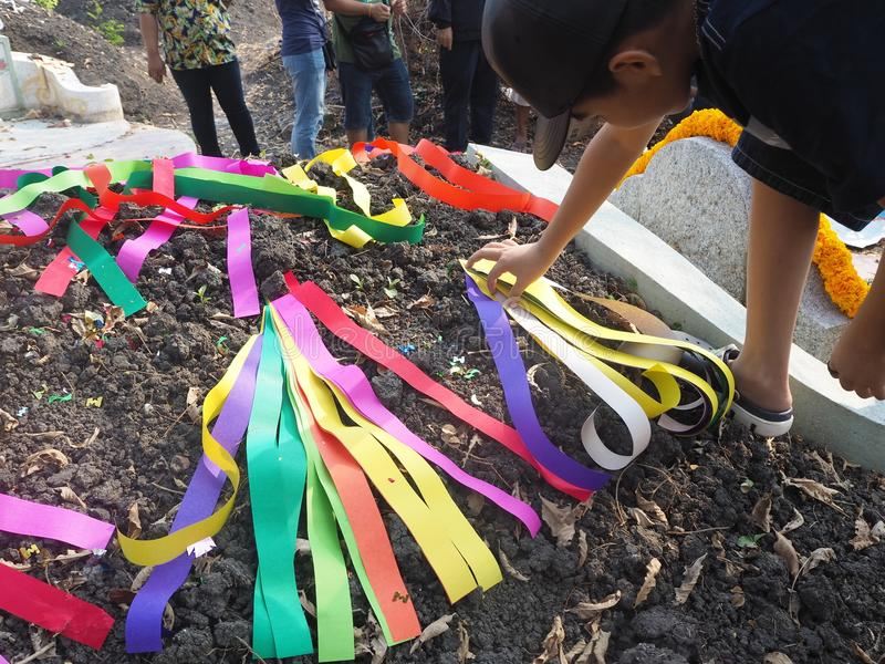 Ratchaburi , Thailand - April 05,2018 : Thai people decorating colorful paper decoration on Chinese graveyard in Qingming Festival.  royalty free stock photo