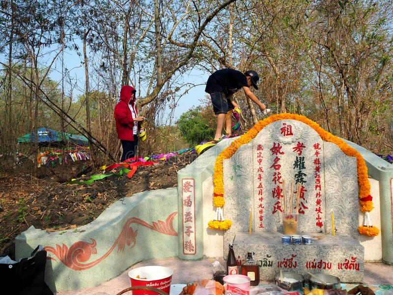 Ratchaburi , Thailand - April 05,2018 : Thai people decorating colorful paper decoration on Chinese graveyard in Qingming Festival.  stock photos