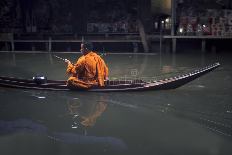 Ratchaburi thailand - january1,2019 : thai monk sailing boat in dumneonsaduak canal ,floating market one of most popular traveling. Destination in ratchaburi royalty free stock photos