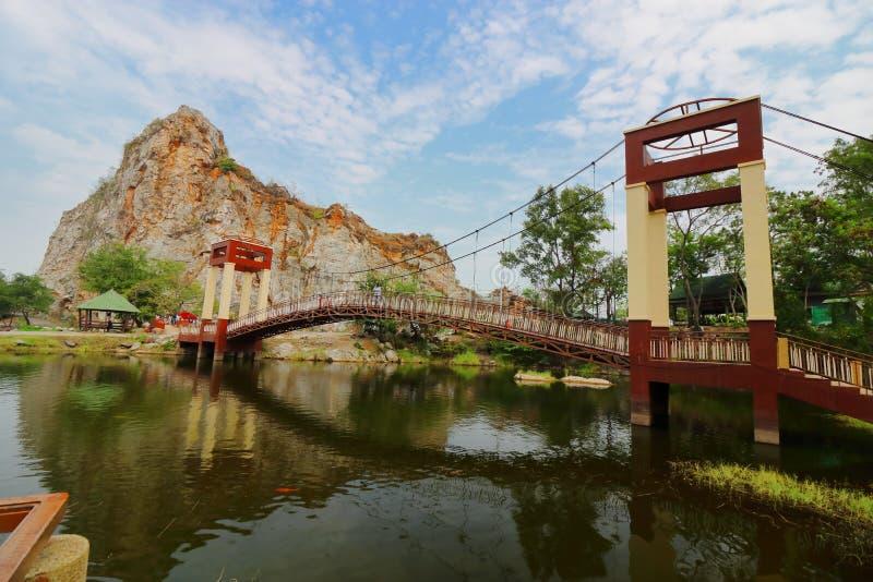 Ratchaburi , Thailand - March 10 , 2018 : Bridge over water lake of khao Ngu Stone Park royalty free stock photo