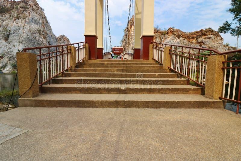 Ratchaburi , Thailand - March 10 , 2018 : Bridge over water lake of khao Ngu Stone Park royalty free stock images