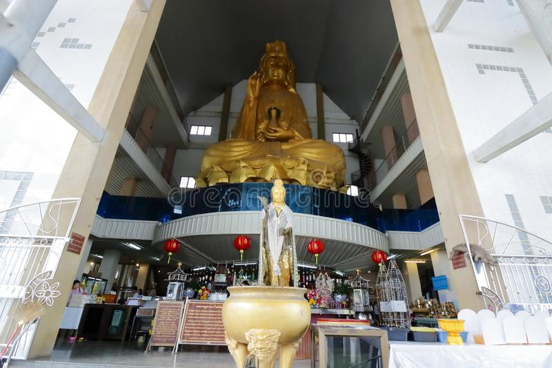 Ratchaburi , Thailand - March 10 , 2018 : Wide angle shot of the large golden statue of Guan Im at Nong Hoi temple stock photos