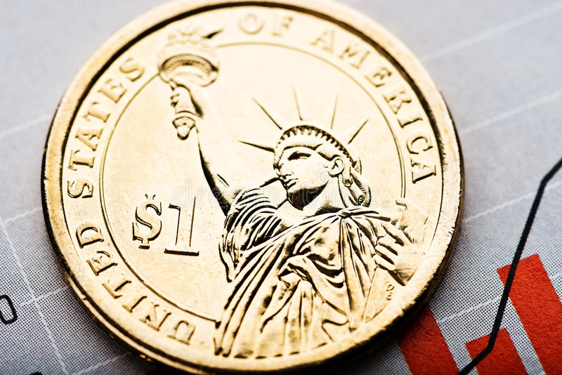 Rate of the us dollar. One dollar coin on fluctuating graph. Rate of the us dollar shallow DOF stock photos