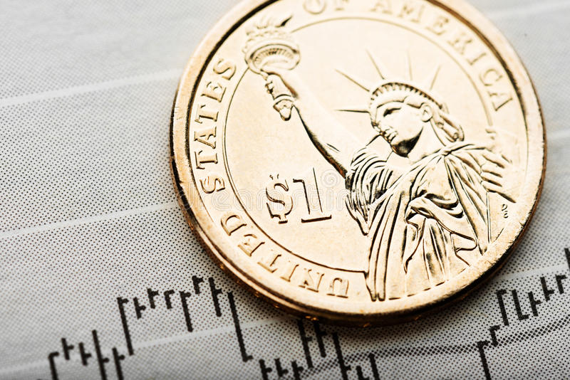 Rate of the us dollar shallow DOF. One dollar coin on fluctuating graph. Rate of the us dollar shallow DOF royalty free stock photography