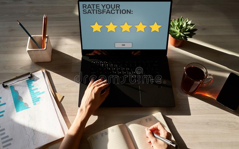 Rate your experience. Customer satisfaction review. Five star on device screen. Service quality control concept. stock images