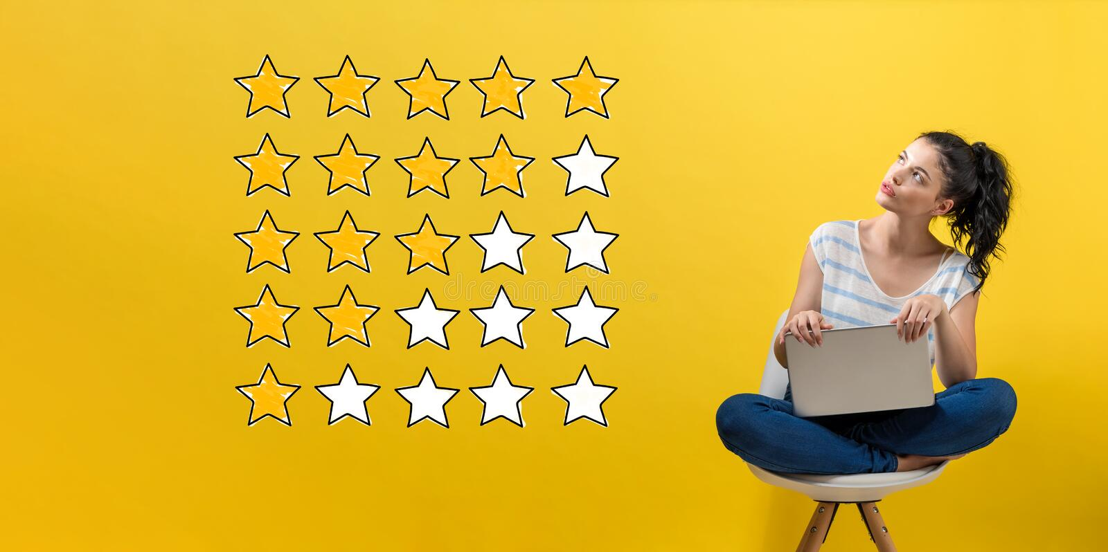 Rating with yellow stars with woman using a laptop. Rating with yellow stars with young woman using a laptop computer royalty free stock photos