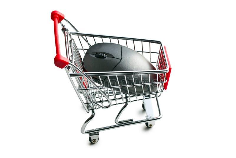 Rato do computador no carrinho de compras foto de stock