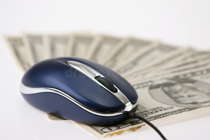 Rato e dinheiro do computador imagem de stock