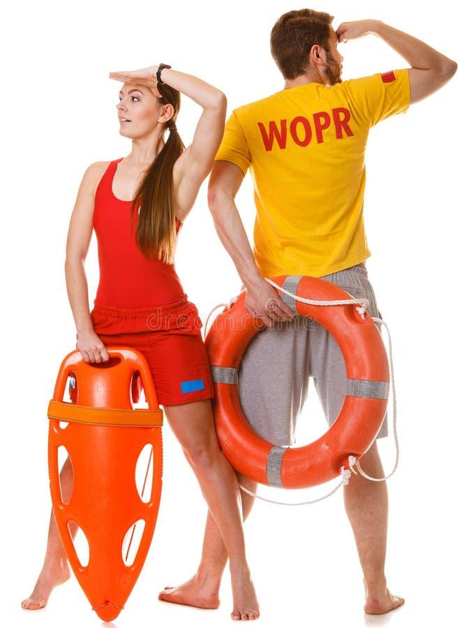 Ratownicy z ratowniczy i ringowy boja lifebuoy zdjęcie stock
