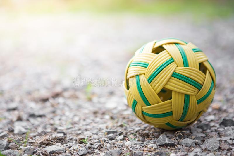 Rattan ball on the ground rubble. On blurred background stock image